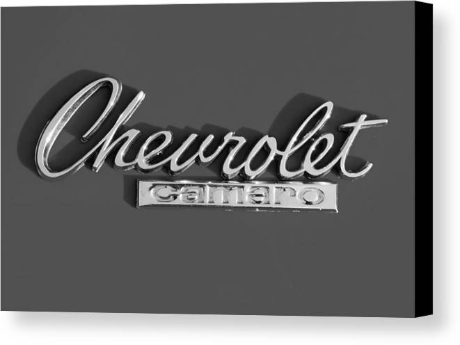 Camaro Canvas Print featuring the photograph Camaro Logo In Black And White by Linda McAlpine