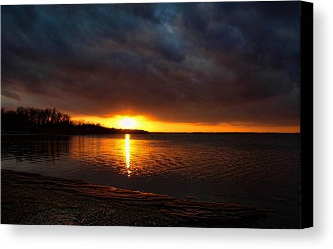 Sunset Canvas Print featuring the photograph Darkness And Light by Carolyn Fletcher