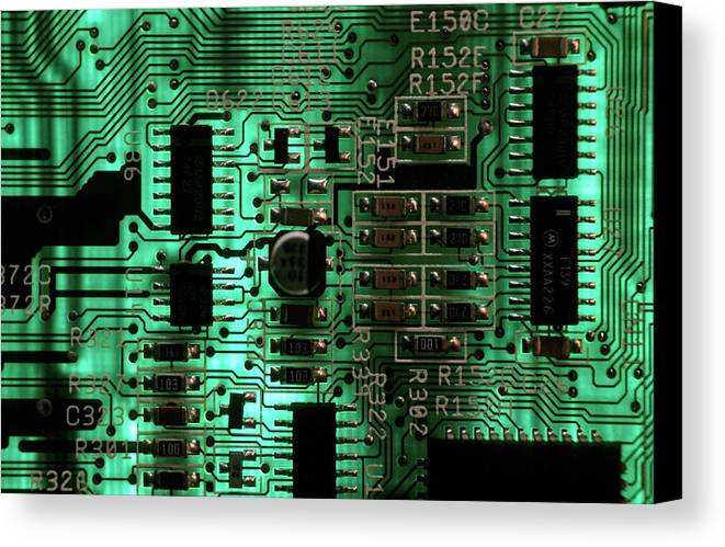 Circuit Board Canvas Print featuring the photograph Integrated Circuit Board From A Computer by Sami Sarkis