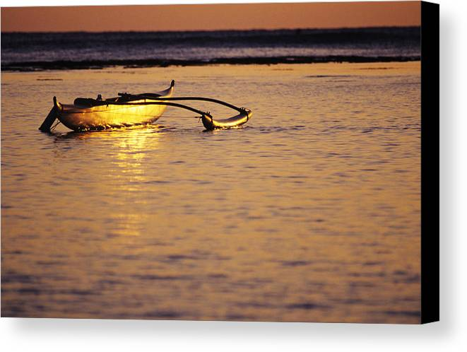 Aku Canvas Print featuring the photograph Outrigger And Sunset by Joss - Printscapes