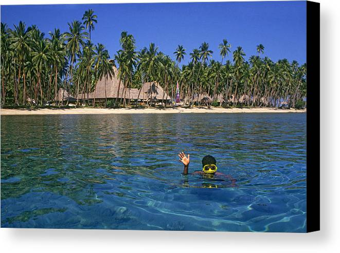 Snorkle Canvas Print featuring the photograph Tourist On Vanua Levu, Fiji by Buddy Mays