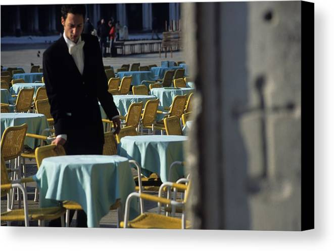 Venice Canvas Print featuring the photograph Waiter Preparing For The Day In Piazza San Marco In Venice by Michael Henderson