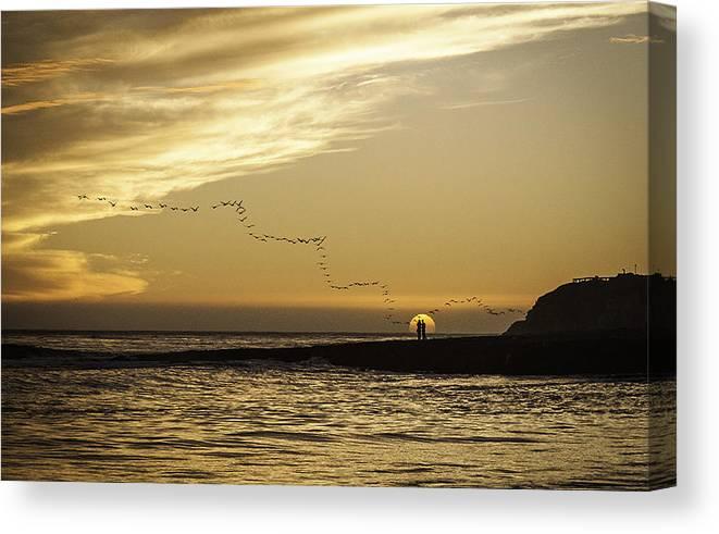 Sunset Ocean Coast Beach santa Cruz Rock Lovers Birds Waves California Orange Sun Shore Pacific Canvas Print featuring the photograph Sunset At Natural Bridges By David Kerbyson by California Coastal Commission