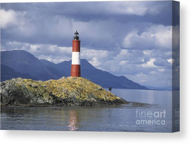 Lighthouse Canvas Print featuring the photograph The Lighthouse At The End Of The World by James Brunker