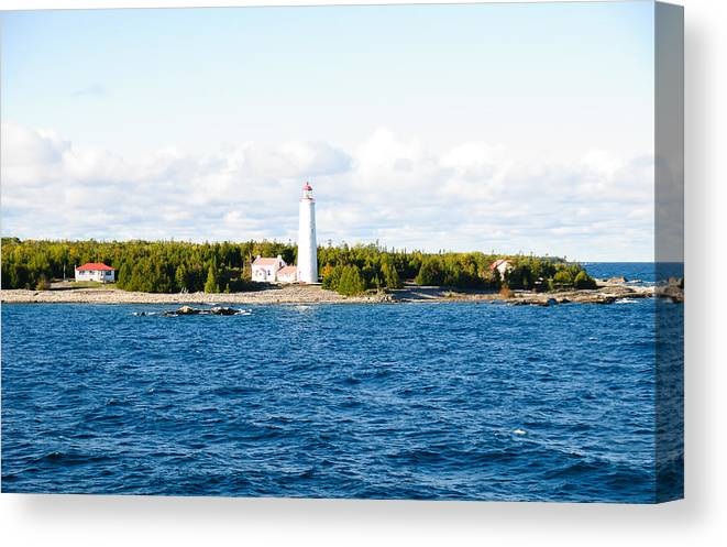 Bruce Penninsula Canvas Print featuring the photograph The Lighthouse by David Jenniskens