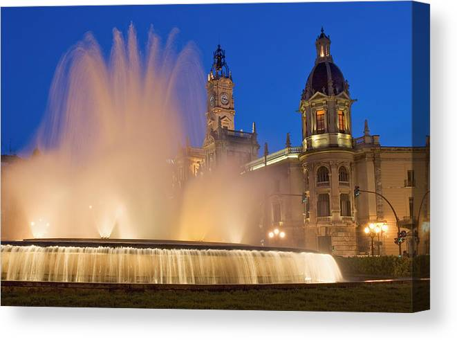Water Canvas Print featuring the photograph City Hall And Fountain At Dusk by Axiom Photographic