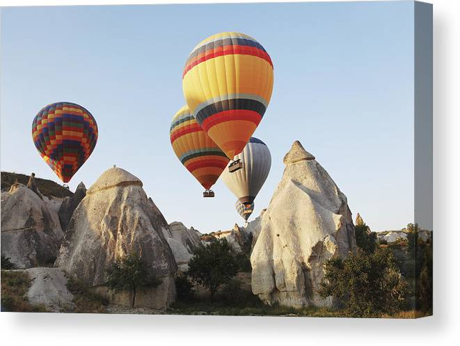 Interesting Canvas Print featuring the photograph Hot Balloons Over Peaks by Kantilal Patel