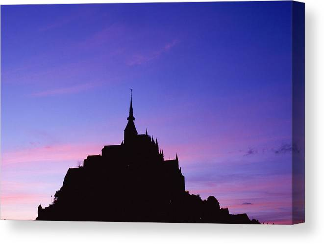 Atmosphere Canvas Print featuring the photograph Mont St. Michel At Sunset by Axiom Photographic