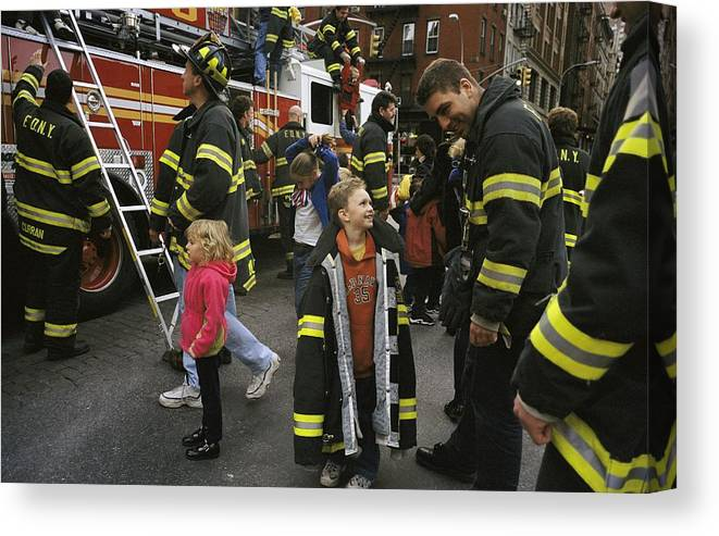 Firemen And Fire Fighters Canvas Print featuring the photograph New York City Firefighters Host by Ira Block
