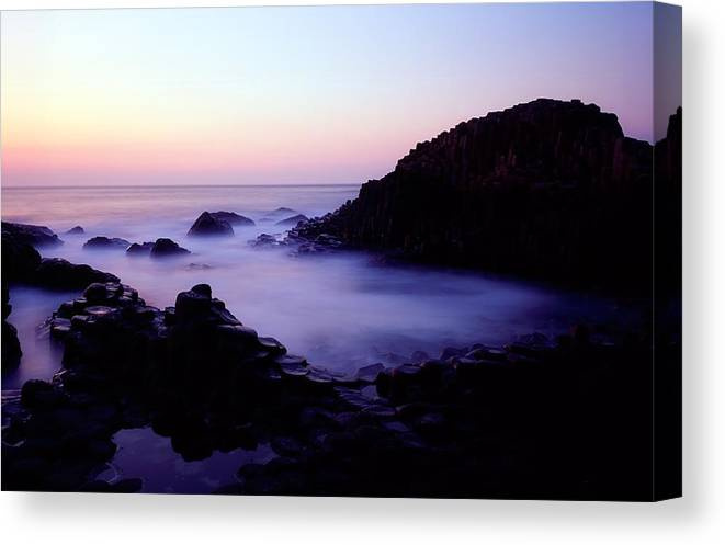 Back Lit Canvas Print featuring the photograph The Giants Causeway, Co Antrim, Ireland by The Irish Image Collection