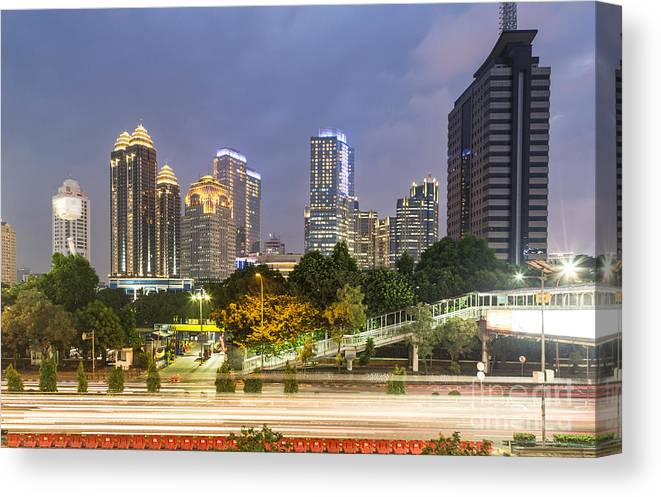 Indonesia Canvas Print featuring the photograph Jakarta Twilight by Didier Marti