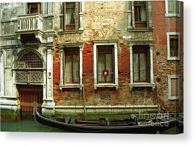 Venice Canvas Print featuring the photograph Gondola In Front Of House In Venice by Michael Henderson
