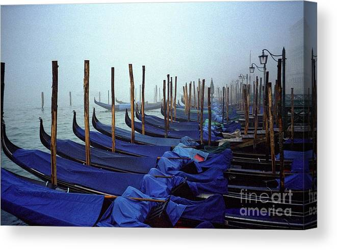 Venice Canvas Print featuring the photograph Gondolas In Venice In The Morning by Michael Henderson