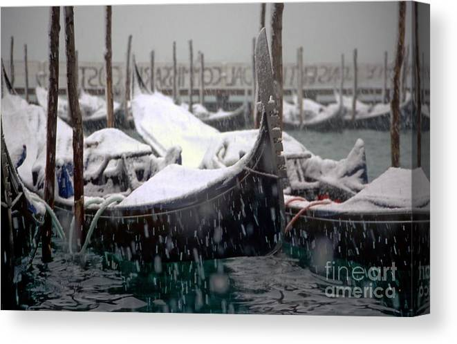 Venice Canvas Print featuring the photograph Gondolas In Venice In The Snow by Michael Henderson