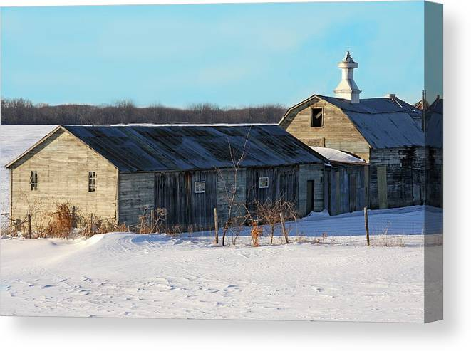Snow Canvas Print featuring the photograph Old Barns And Snow by Dave Clark