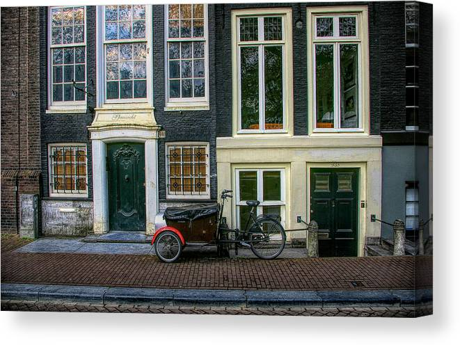 Bike Canvas Print featuring the photograph Amsterdam Bike Scene by Tom Reynen