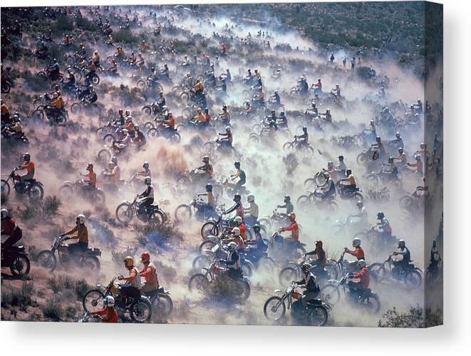 Crash Helmet Canvas Print featuring the photograph Mint 400 Motocross Race by Bill Eppridge