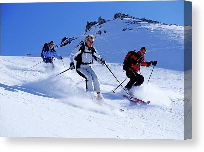 Ski Pole Canvas Print featuring the photograph Three Young People, Two Women And A by Bernard Van Dierendonck / Look-foto