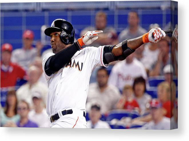 American League Baseball Canvas Print featuring the photograph Marcell Ozuna by Rob Foldy