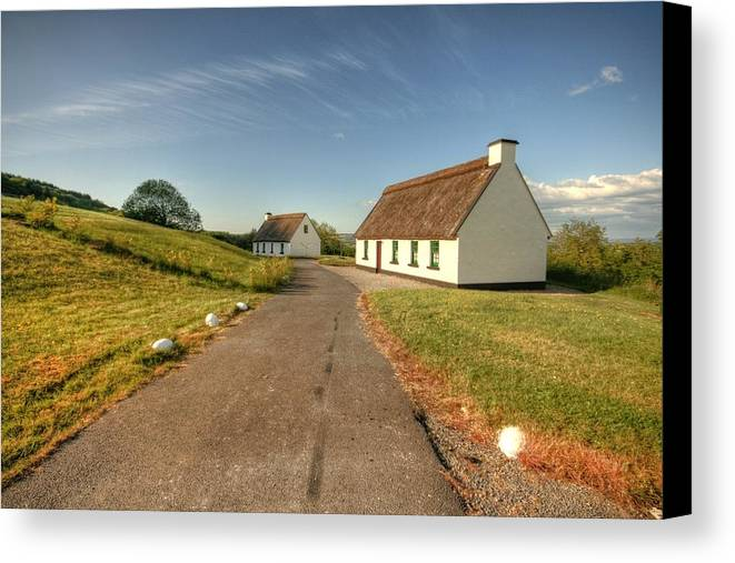 Beautiful Ireland Canvas Print featuring the photograph Corofin Thatched Cottages by John Quinn