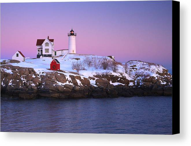 Atlantic Ocean Canvas Print featuring the photograph Nubble Light Under A Pastel Winter Sky by Jeff Sinon