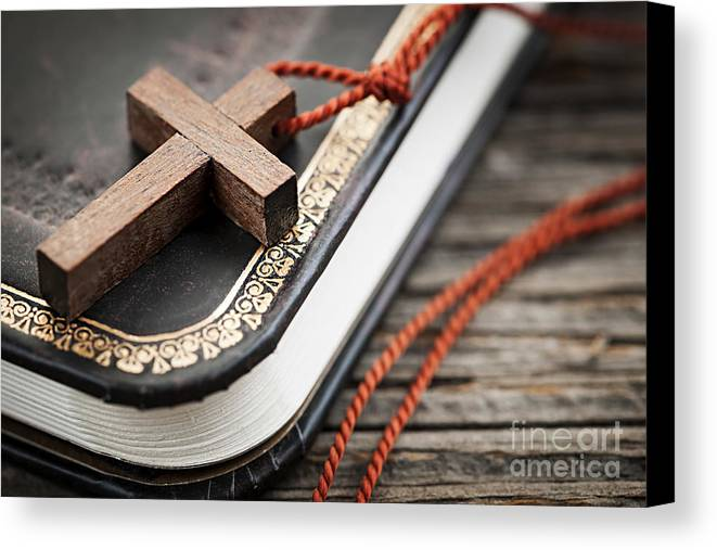 Cross Canvas Print featuring the photograph Cross On Bible by Elena Elisseeva