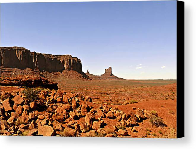 Monument Canvas Print featuring the photograph Utah's Iconic Monument Valley by Christine Till