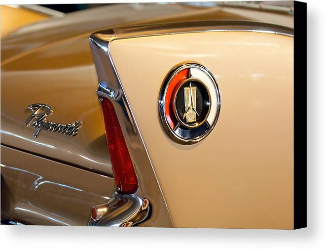 1960 Plymouth Fury Convertible Canvas Print featuring the photograph 1960 Plymouth Fury Convertible Taillight And Emblem by Jill Reger