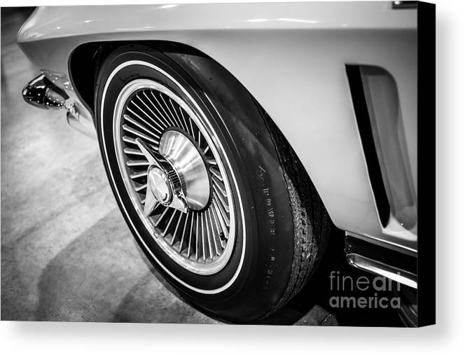 1960's Canvas Print featuring the photograph 1960's Chevrolet Corvette C2 Spinner Wheel by Paul Velgos