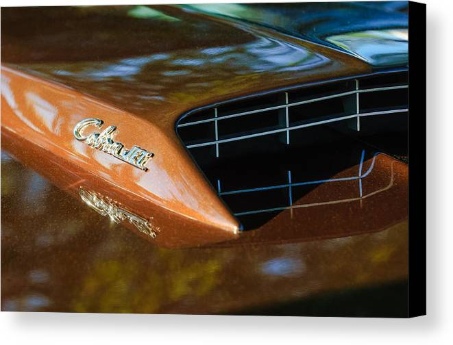 1967 Ford Mustang Cobra Jet Hood Emblem Canvas Print featuring the photograph 1967 Ford Mustang Cobra Jet Hood Emblem by Jill Reger