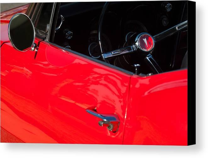 1967 Pontiac Firebird Steering Wheel Emblem Canvas Print featuring the photograph 1967 Pontiac Firebird Steering Wheel Emblem by Jill Reger