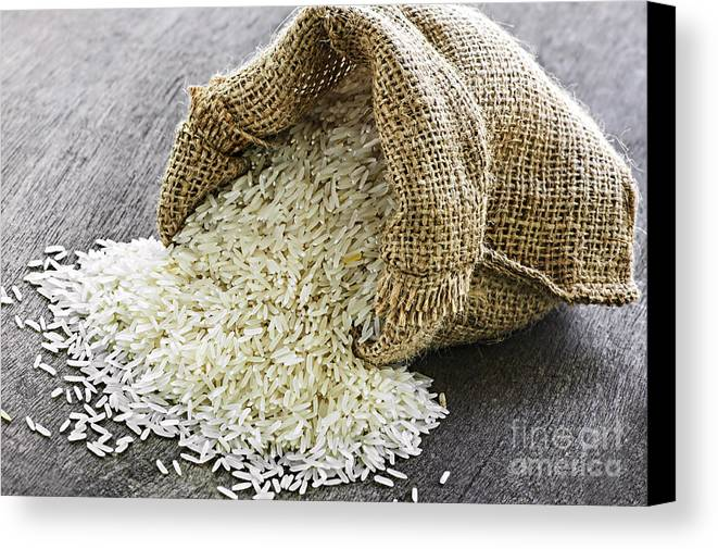 Rice Canvas Print featuring the photograph Long Grain Rice In Burlap Sack by Elena Elisseeva