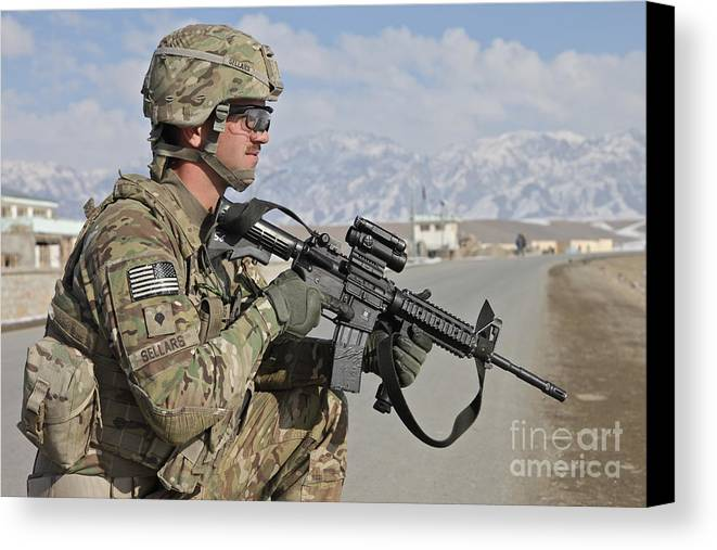 Us Army Canvas Print featuring the photograph U.s. Army Specialist Provides Security by Stocktrek Images