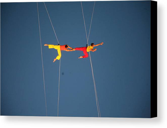 Acrobats Canvas Print featuring the photograph Acrobats by Shaeley Garrett
