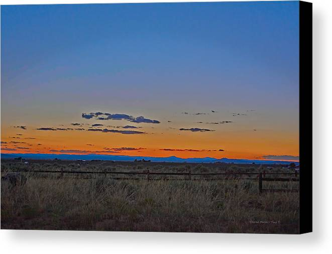 Afterglow Canvas Print featuring the photograph Afterglow by Charles Muhle