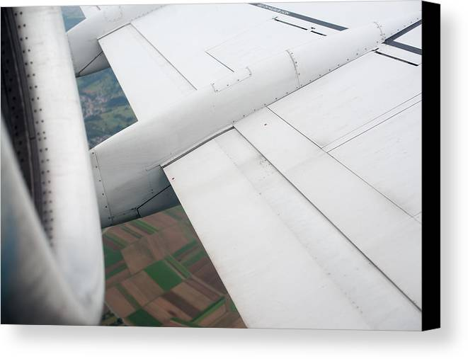 Airplane Canvas Print featuring the photograph Airplane Wing And Turbine by Frank Gaertner