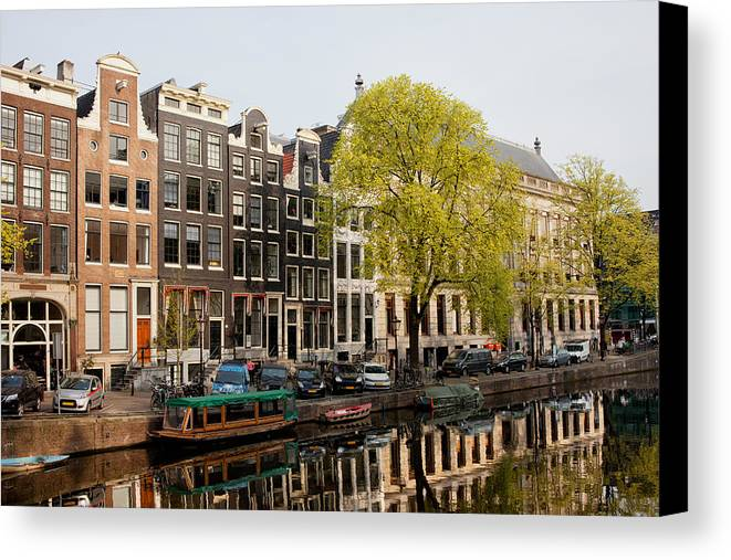 Amsterdam Canvas Print featuring the photograph Amsterdam Houses Along The Singel Canal by Artur Bogacki