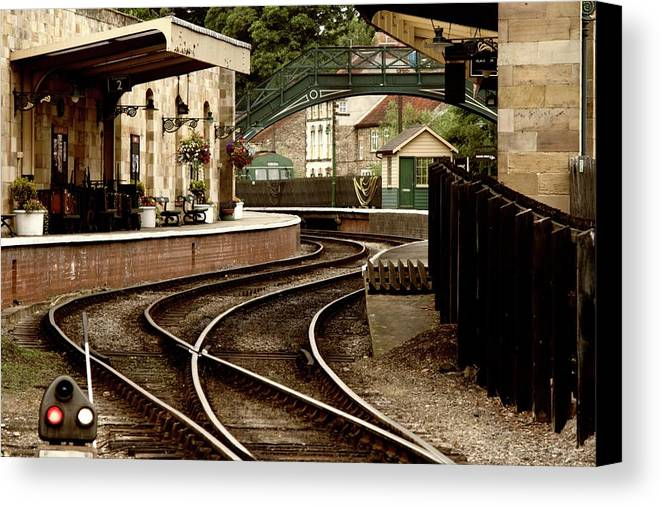 Architectural Exterior Canvas Print featuring the photograph An Old-fashioned Train Station by John Short