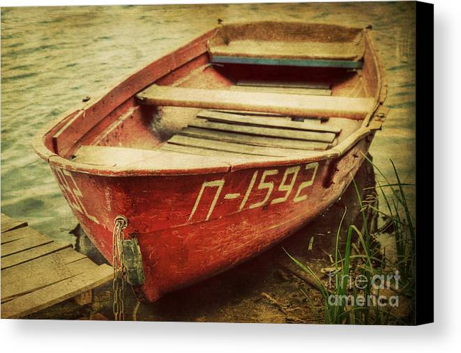 Boat Canvas Print featuring the photograph An Old Row Boat by Emily Kay