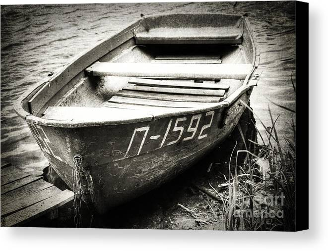 Kazakh Canvas Print featuring the photograph An Old Row Boat In Black And White by Emily Kay