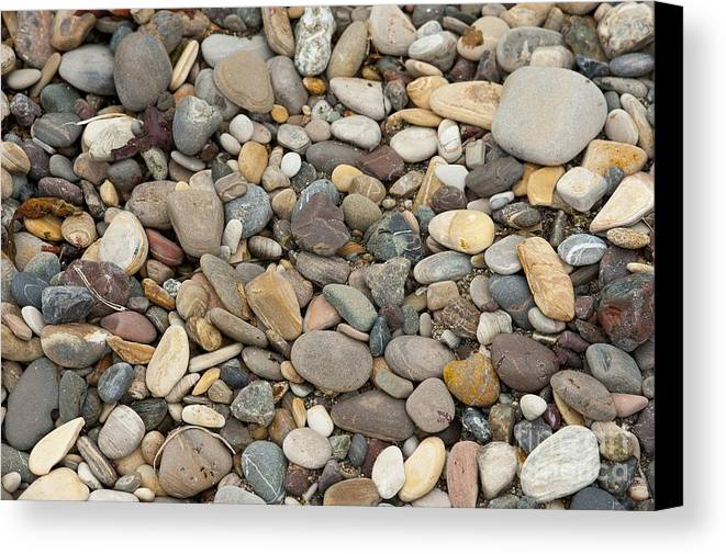 Ocean Canvas Print featuring the photograph Beach Rocks by Artist and Photographer Laura Wrede
