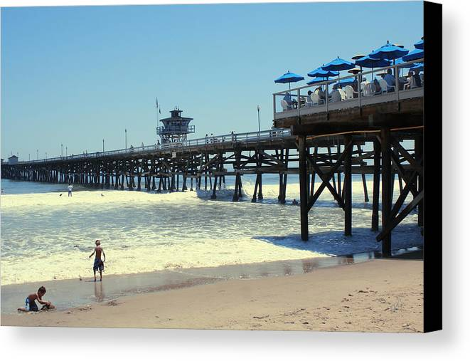 Childhood Canvas Print featuring the photograph Beach View With Pier 1 by Ben and Raisa Gertsberg