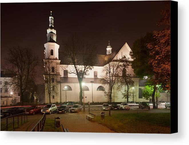 Krakow Canvas Print featuring the photograph Bernandine Church At Night In Krakow by Artur Bogacki