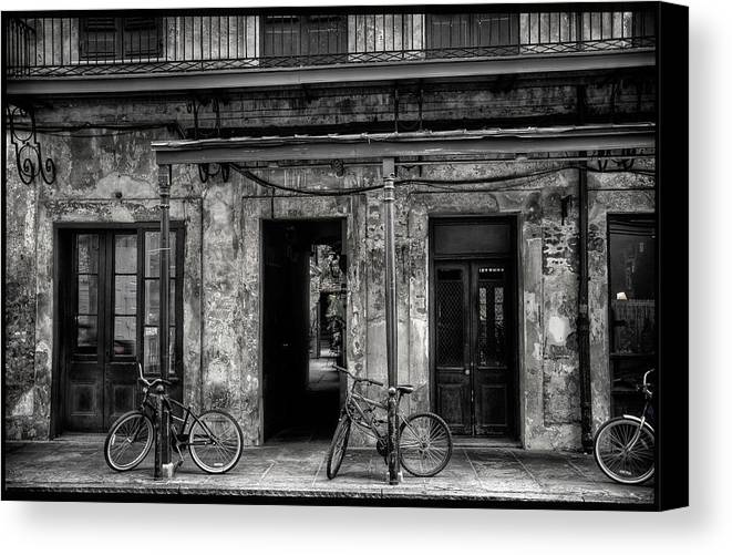 New Orleans Canvas Print featuring the photograph Bicycles On Posts by Richard Herman