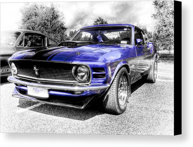 Blue Ford Mustang Canvas Print featuring the photograph Blue Mach 1 by motography aka Phil Clark