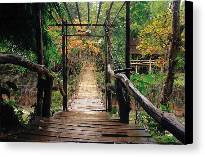 Bridge Canvas Print featuring the photograph Bridge Over Waterfall by Nawarat Namphon