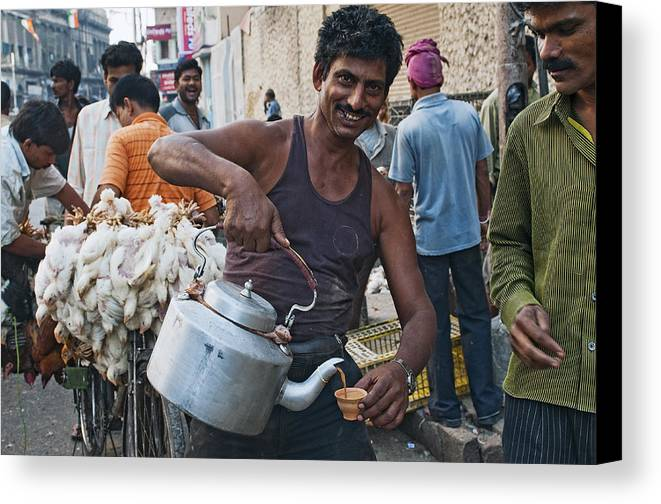 India Canvas Print featuring the photograph Calcutta - A Chai-wallah At The Chicken Market by Urs Schweitzer