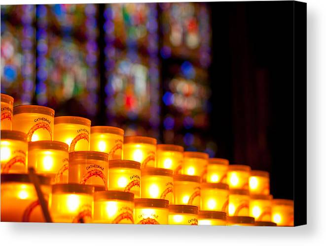 Notre Dame Canvas Print featuring the photograph Candles In Notre Dame by Anthony Doudt