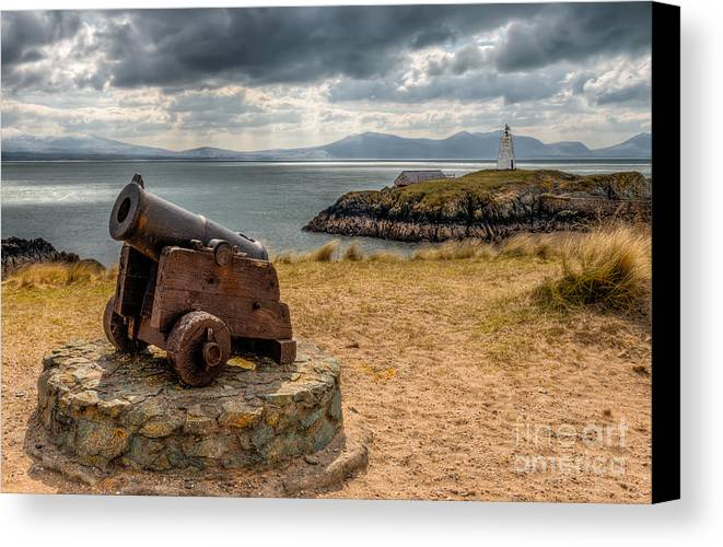 Anglesey Canvas Print featuring the photograph Cannon At Llanddwyn by Adrian Evans