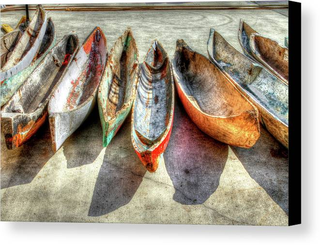 The Canvas Print featuring the photograph Canoes by Debra and Dave Vanderlaan